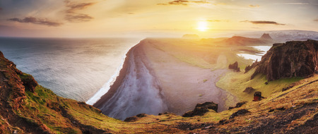 Landscape with ocean and Reynisfjall mount Iceland Stock Photo