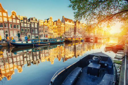 Canal at sunset. Amsterdam is the capital and most populous city in Netherlands. Stock Photo