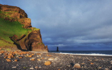Reynisfjara black sand beach in Iceland. Reynisfyal Mountains.