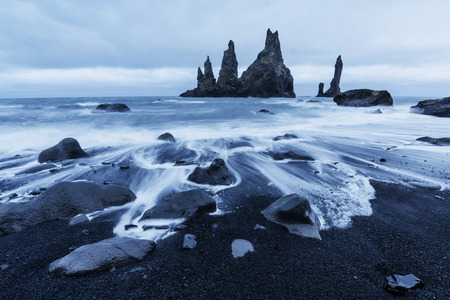 The Rock Troll Toes. Reynisdrangar cliffs. Black sand beach Iceland