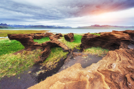 Texture of rocks melted by volcanic magma. Stock Photo