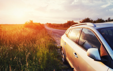 road car on a field at sunset. Ukraine Europe