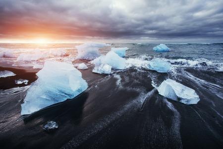 Jokulsarlon glacier lagoon fantastic sunset on the black beach, Stock Photo