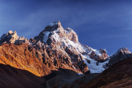 Fantastic scenery and snowy peaks in the first morning sunlight.