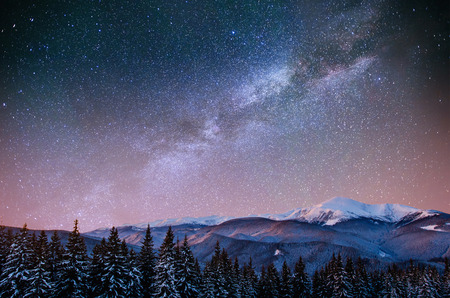 fantastic winter meteor shower and the snow-capped mountains. Ca 스톡 콘텐츠