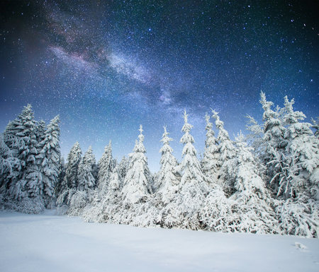 fantastic winter meteor shower and the snow-capped mountains. Ca Stock Photo