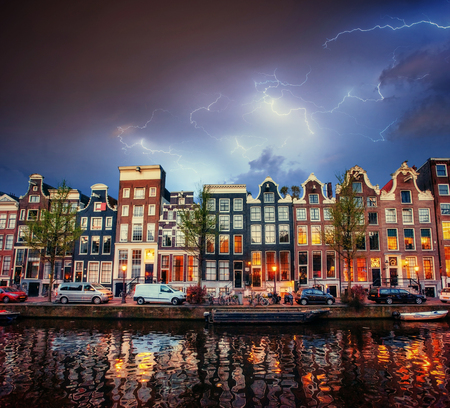 Amsterdam canal at beautiful cumulus clouds and lightning