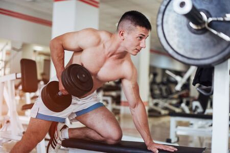 Beautiful man with big muscles, posing for the camera