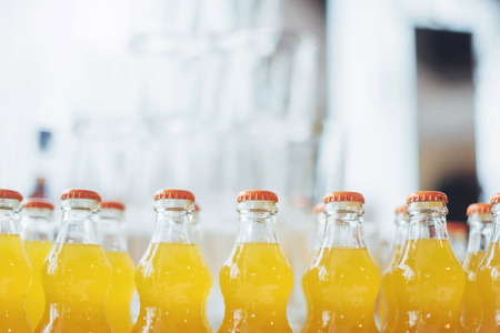 bottle of Orange Fanta glass soda Imagens
