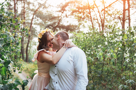 smooch: Beautiful happy couple on a walk in the woods