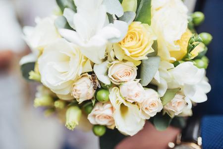 arm bouquet: wedding bouquet in hands of the groom