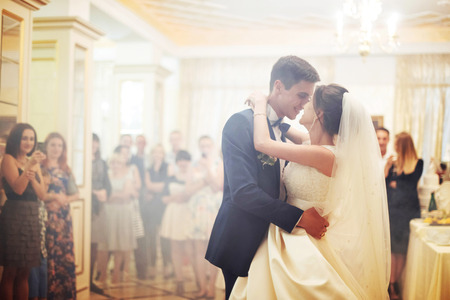 Happy bride and groom their first dance Imagens