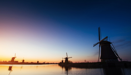 rott: Colorful spring sunset traditional Dutch windmills canal in Rott