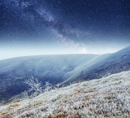 fantastic winter meteor shower and the snow-capped mountains Stock Photo