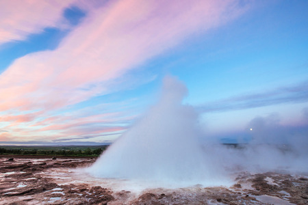 Strokkur geyser eruption in Iceland. Fantastic colors shine thro Stock Photo