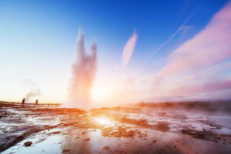 Fantastic sunset Strokkur geyser eruption in Iceland. Standard-Bild