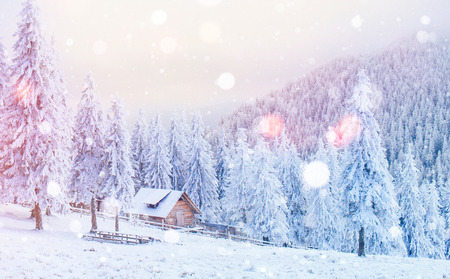 cabin in the mountains in winter, background with some soft high Stock Photo