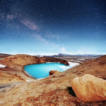 Giant volcano overlooks. Turquoise provides a warm geothermal 스톡 콘텐츠