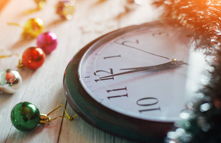 New Year Midnight - clock on background wooden