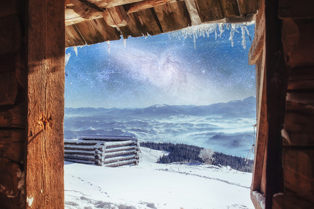 chalets in the mountains at night under the stars. Magic event i Stock Photo