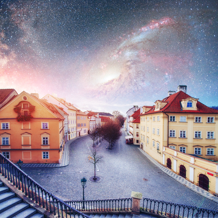 Fantastic starry sky and the milky way. Beautiful houses Czech R Stock Photo