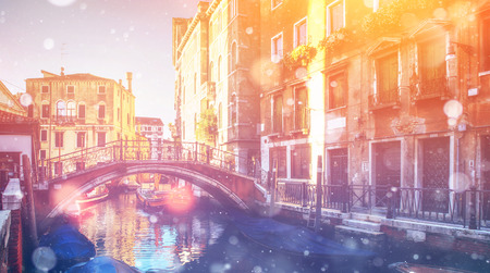 Canal with gondolas in Venice, Italy. Photo greeting card. Bokeh