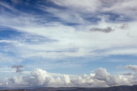 Many cumulonimbus cloud before raining with blue sky.