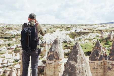 Man takes pictures of the valley love altitude mountains. Cappadocia, Turkey