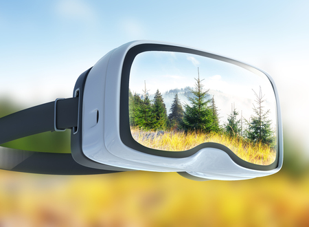 Virtual reality headset, double exposure, View of mountain peaks in spring