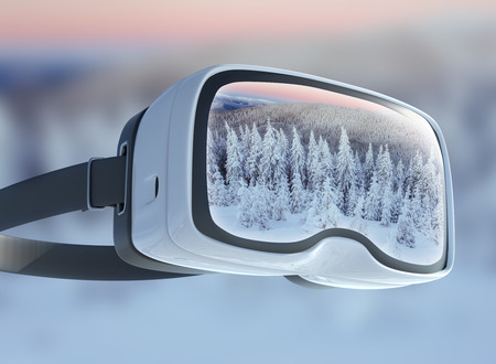 Virtual reality headset, double exposure. Mysterious landscape majestic mountains in winter. Magical winter snow covered tree. Winter road in the mountains. In anticipation of the holiday. Dramatic wintry scene. Carpathian. Ukraine. Stock Photo