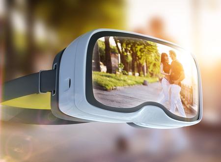 Virtual reality headset, double exposure. Young couple dancing tango on the quay