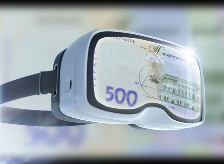 Virtual reality glasses, business, technology, internet and networking concept. UAH banknotes and abstract representing the cryptocurrency or digital money.