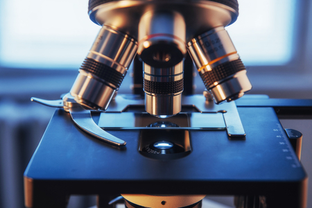 sample tray: microscope close-up shot in the laboratory. Medical equipment