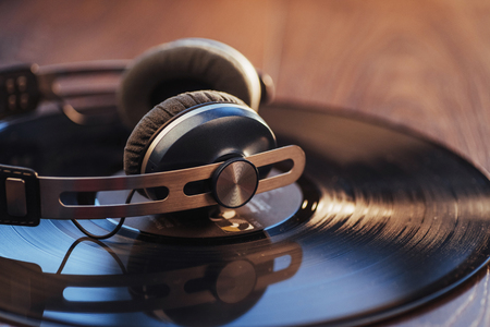 vinyl record and headphone over wooden table. Audio enthusiast,music lover or professional disc jockey equipment