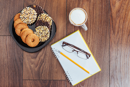Top view of notebook, stationery, drawing tools and a few cups of coffee Reklamní fotografie - 74315652