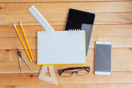 Top view of notebook, stationery, drawing tools and a few glasses. improvise Reklamní fotografie - 74315807