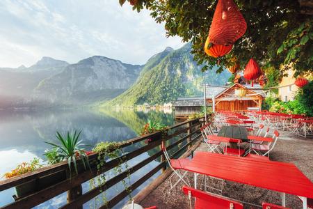 Summer cafe on the beautiful lake between mountains. Alps. Hallstatt Austria