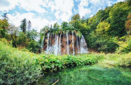 Waterfalls in national park falling into turquoise lake. Plitvice Croatia