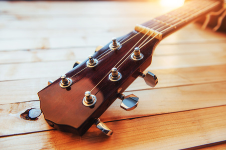 close up neck acoustic classical guitar on a light wooden background. Stock Photo