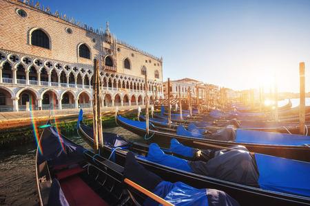 Gondolas in Venice - sunset with San Giorgio Maggiore church. San Marco, Venice, Italy
