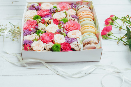 Beautiful colors of flowers and tasty Bizet. Isolated on white background.