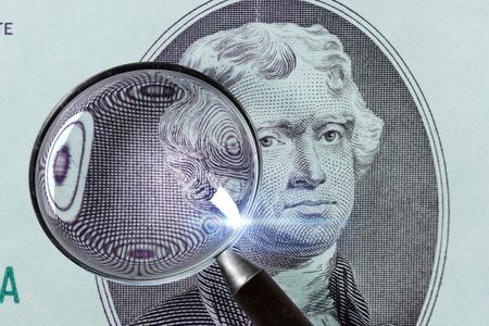2 dollar bills great plan. US two dollar bills macro. Dollar under magnifying glass. Stock Photo