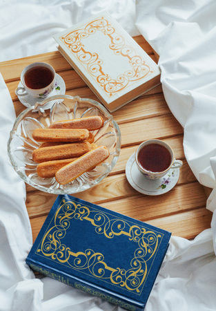cup of tea, cookies and books isolated