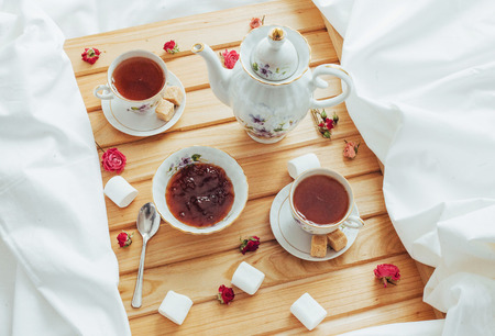 cup of tea, teapot, spoon and sugar isolated