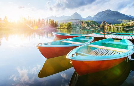 Boat on the dock surrounded mountains. Fantastic Shtrbske Pleso High Tatras. Slovakia