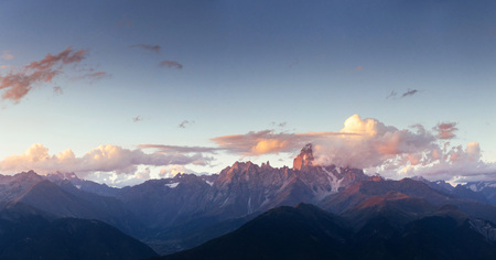 Fantastic snow-capped mountains in the beautiful cumulus clouds Stock Photo