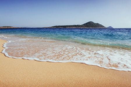 Fantastic views of the sea coast with yellow sand and blue water.