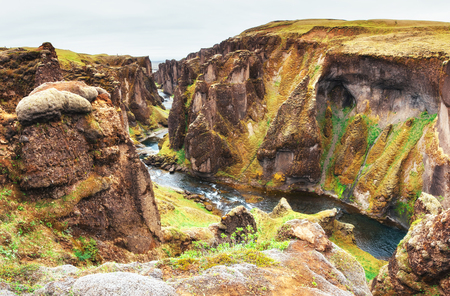 Iceland. Rocky mountains and river between them Stok Fotoğraf