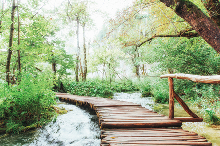 Plitvice Lakes National Park, tourist route on the wooden flooring along the waterfall