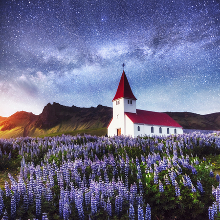 Beautiful collage Lutheran Church in Vik under fantastic starry sky. Iceland.